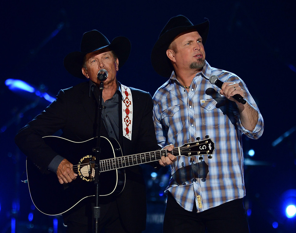 . Musicians George Strait (L) and Garth Brooks perform onstage during the 48th Annual Academy of Country Music Awards at the MGM Grand Garden Arena on April 7, 2013 in Las Vegas, Nevada.  (Photo by Ethan Miller/Getty Images)