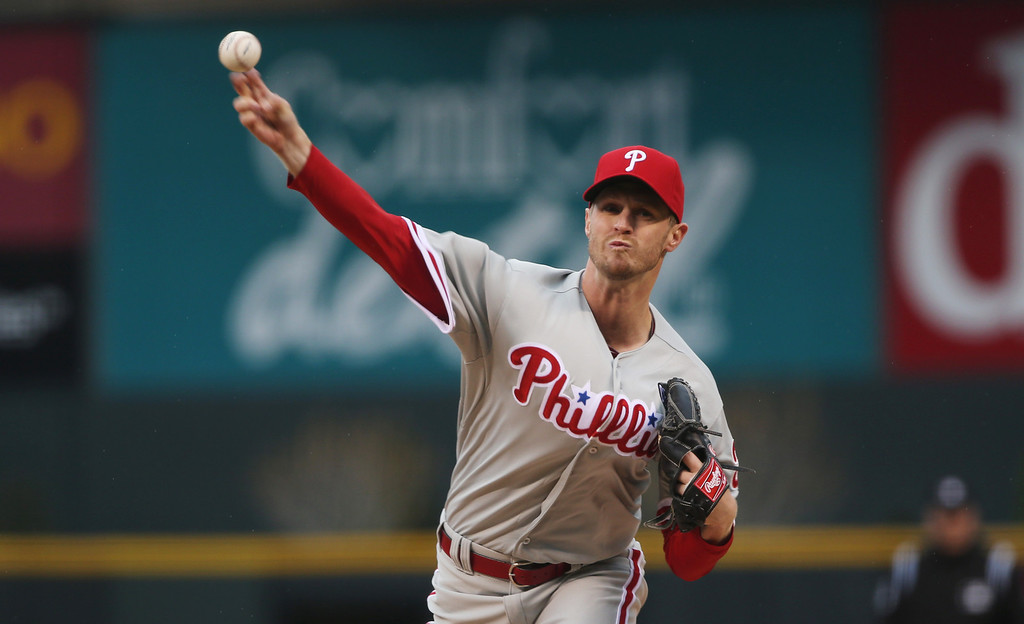 . Philadelphia Phillies starting pitcher Kyle Kendrick works against the Colorado Rockies in the first inning of a baseball game in Denver on Saturday, April 19, 2014. (AP Photo/David Zalubowski)
