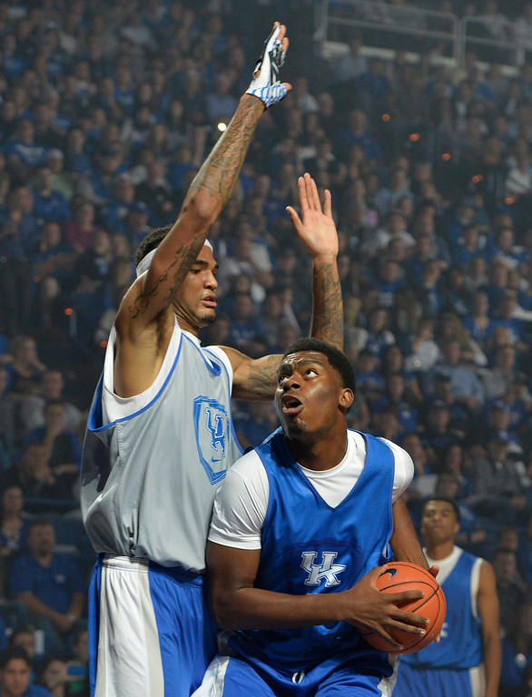 . Kentucky\'s Dakari Johnson, right, looks for an open shot past the defense of Willie Cauley-Stein during the NCAA college basketball team\'s Big Blue Madness scrimmage, Friday, Oct. 18, 2013, in Lexington, Ky. (AP Photo/Timothy D. Easley)