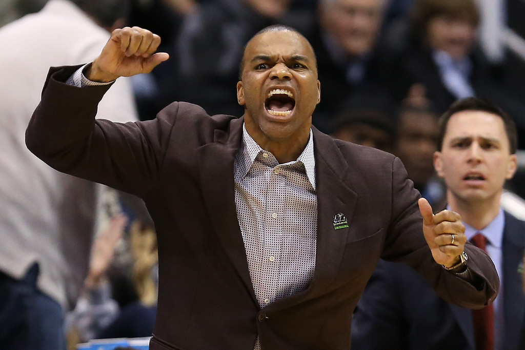 . SALT LAKE CITY, UT - MARCH 21:  Head coach Tommy Amaker of the Harvard Crimson reacts in the second half while taking on the New Mexico Lobos during the second round of the 2013 NCAA Men\'s Basketball Tournament at EnergySolutions Arena on March 21, 2013 in Salt Lake City, Utah.  (Photo by Streeter Lecka/Getty Images)