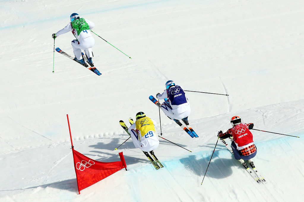 . Gold medallist Jean Frederic Chapuis (L) of France leads from silver medallist Arnaud Bovolenta of France, Brady Leman (red top) of Canada and bronze medallist Jonathan Midol (2ndL) of France during the Freestyle Skiing Men\'s Ski Cross Big Final on day 13 of the 2014 Sochi Winter Olympic at Rosa Khutor Extreme Park on February 20, 2014 in Sochi, Russia.  (Photo by Cameron Spencer/Getty Images)