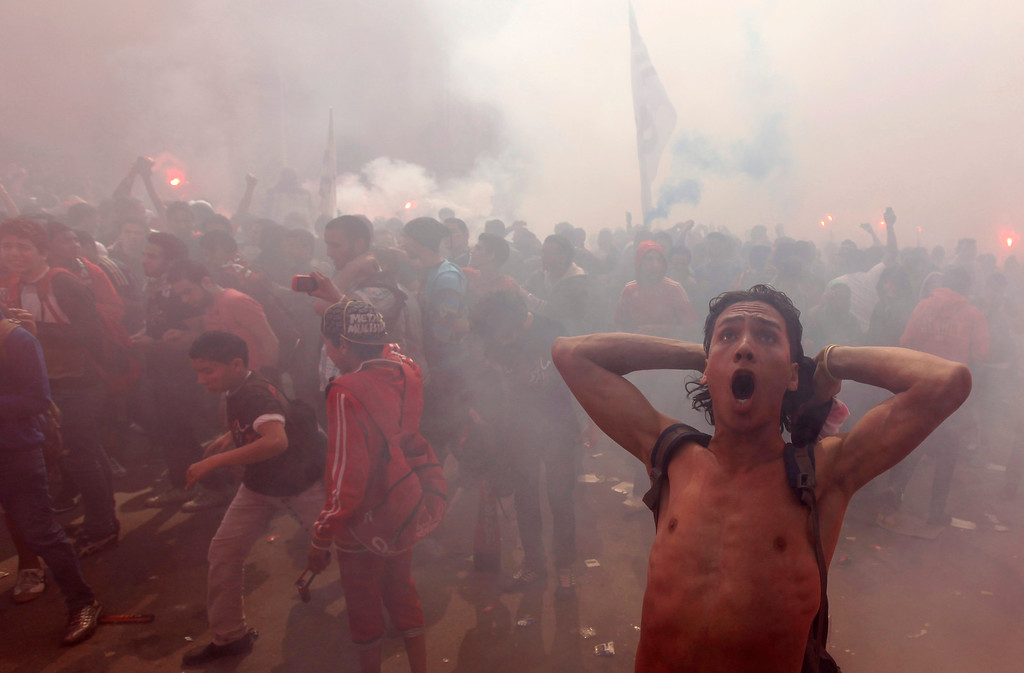 ". Al-Ahly fans, also known as ""Ultras\"", celebrate and shout slogans in front of the Al-Ahly club after hearing the final verdict of the 2012 Port Said massacre in Cairo March 9, 2013. REUTERS/Amr Abdallah Dalsh"