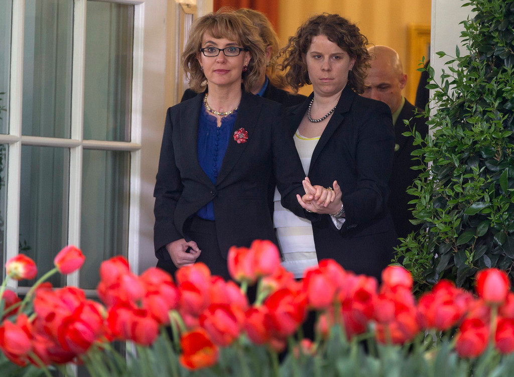 . Former Rep. Gabby Giffords is helped as she arrives for a news conference in the Rose Garden of the White House, Wednesday, April 17, 2013, in Washington, about measures to reduce gun violence and the bill to expand background checks on guns that was defeated in the Senate. (AP Photo/Carolyn Kaster)