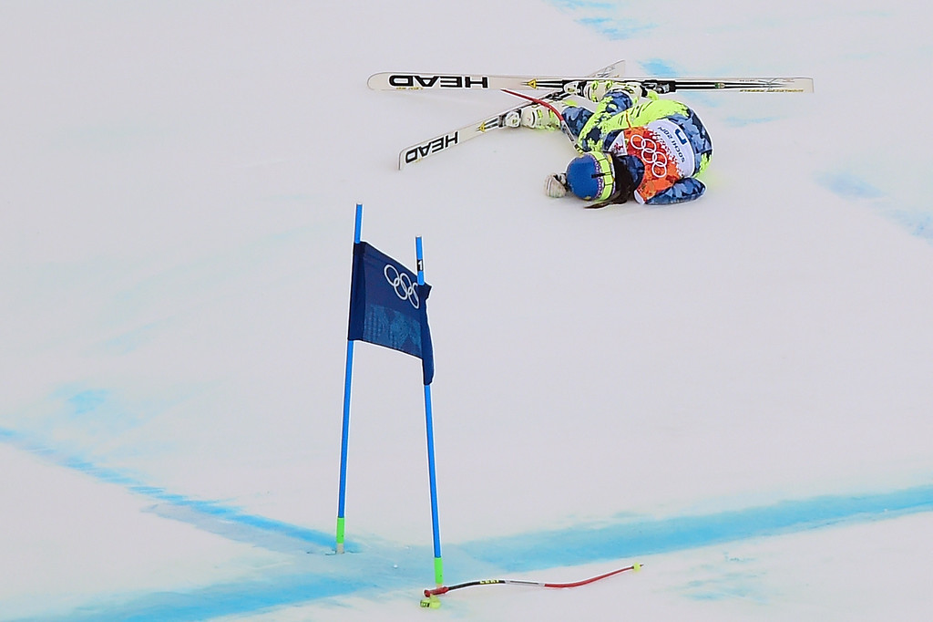 . Chile\'s Noelle Barahona lies on the snow after falling during the Women\'s Alpine Skiing Super Combined Downhill at the Rosa Khutor Alpine Center during the Sochi Winter Olympics on February 10, 2014.        AFP PHOTO / FABRICE COFFRINI/AFP/Getty Images