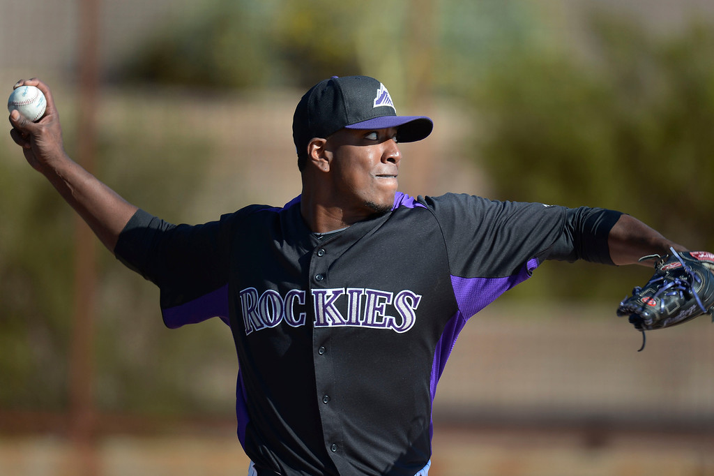 . SCOTTSDALE, AZ. - FEBRUARY 21: Edgmer Escalona (61) of the Colorado Rockies warms up during Spring Training February 21, 2013 in Scottsdale. (Photo By John Leyba/The Denver Post)
