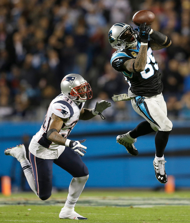 . Carolina Panthers\' Steve Smith (89) catches a pass as New England Patriots\' Aqib Talib (31) defends during the first half of an NFL football game in Charlotte, N.C., Monday, Nov. 18, 2013. (AP Photo/Gerry Broome)