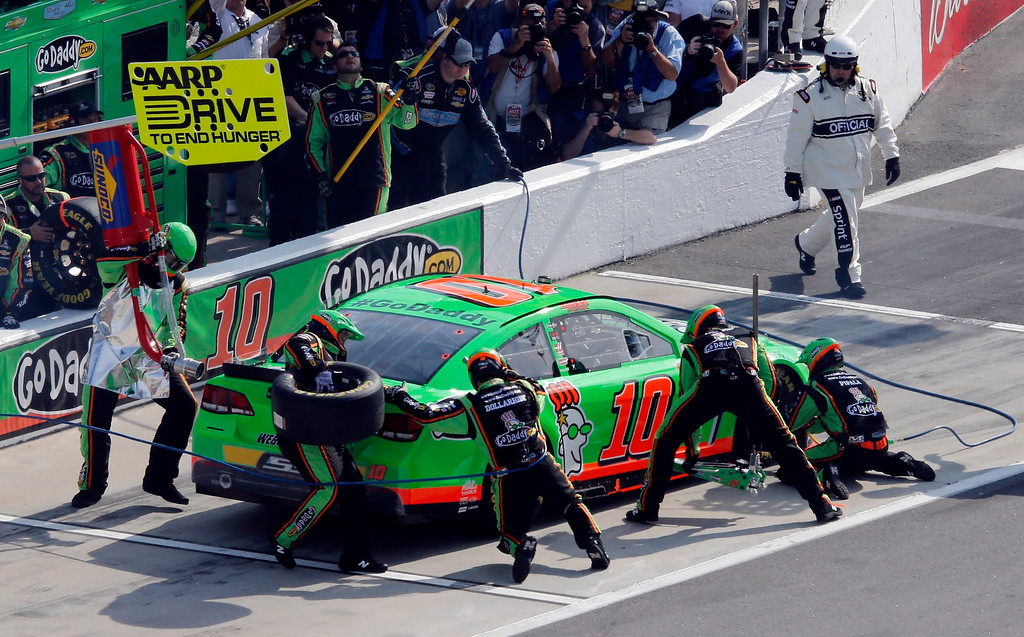 . Danica Patrick makes a pit stop in her number 10 Chevrolet during the first NASCAR Sprint Cup Series Budweiser Duel at the Daytona International Speedway in Daytona Beach, Florida February 21, 2013. The two Duel races determine starting positions for the field for the Daytona 500 NASCAR Sprint Cup race, scheduled for February 24. Patrick won the pole position for the race.        REUTERS/Pierre Ducharme