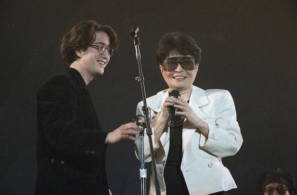 ". Yoko Ono and Sean Lennon,  widow and a son of John Lennon, tell the audience about John\'s life after the opening number ""Power to the People\"" during the \""Greening of the World\""  concert held in evening  on Friday, Dec. 21, 1990 at the Tokyo Dome to celebrate the 50th birthday of John Lennon.  (AP Photo/Tsugufumi Matsumoto)"