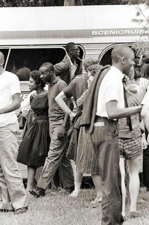 """. An unidentified \""""Freedom Rider\"""" sticks his head out of a chartered bus window in Jackson, Miss., having arrived from New York, Aug. 14, 1961. These black and white Riders challenged the rule of segregation by entering waiting rooms labeled \""""colored\"""" or \""""White\"""" thus testing a Supreme Court ruling banning racial segregation on interstate public transportation.  (AP Photo)"""