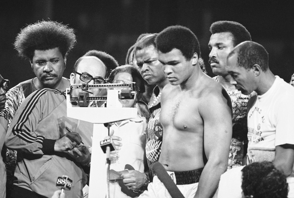 . Muhammad Ali and official read scales during weighing on Saturday, Oct.26, 1974 at stadium in Kinshasa for his fight against heavyweight champion George Foreman in Kinshasa on October 30.   At left is Don King one of the promoters of the fight.   Directly behind scales is Angelo Dundee, Ali?s trainer. Other is Drew Bundini, also a trainer. (AP Photo)