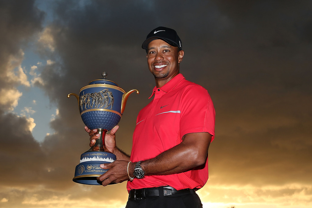 . DORAL, FL - MARCH 10:  Tiger Woods poses with the Gene Sarazen Cup after his two-stroke victory at the World Golf Championships-Cadillac Championship at the Trump Doral Golf Resort & Spa on March 10, 2013 in Doral, Florida.  (Photo by Warren Little/Getty Images)