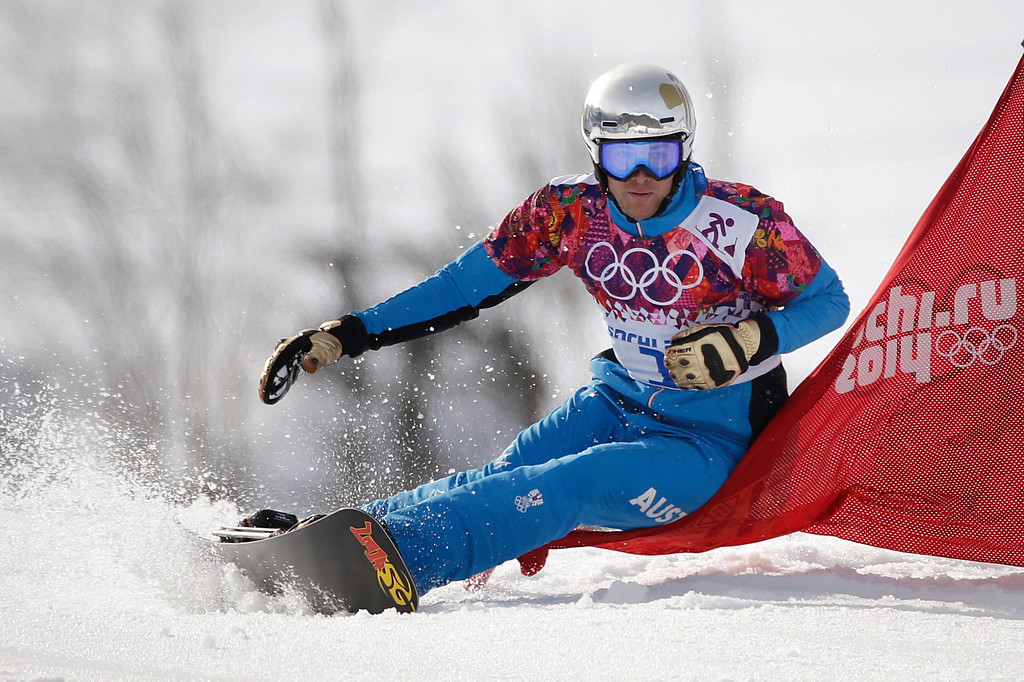 . Austria\'s Benjamin Karl competes in the men\'s snowboard parallel slalom final at the Rosa Khutor Extreme Park, at the 2014 Winter Olympics, Saturday, Feb. 22, 2014, in Krasnaya Polyana, Russia. Karl won the bronze medal. (AP Photo/Jae C. Hong)
