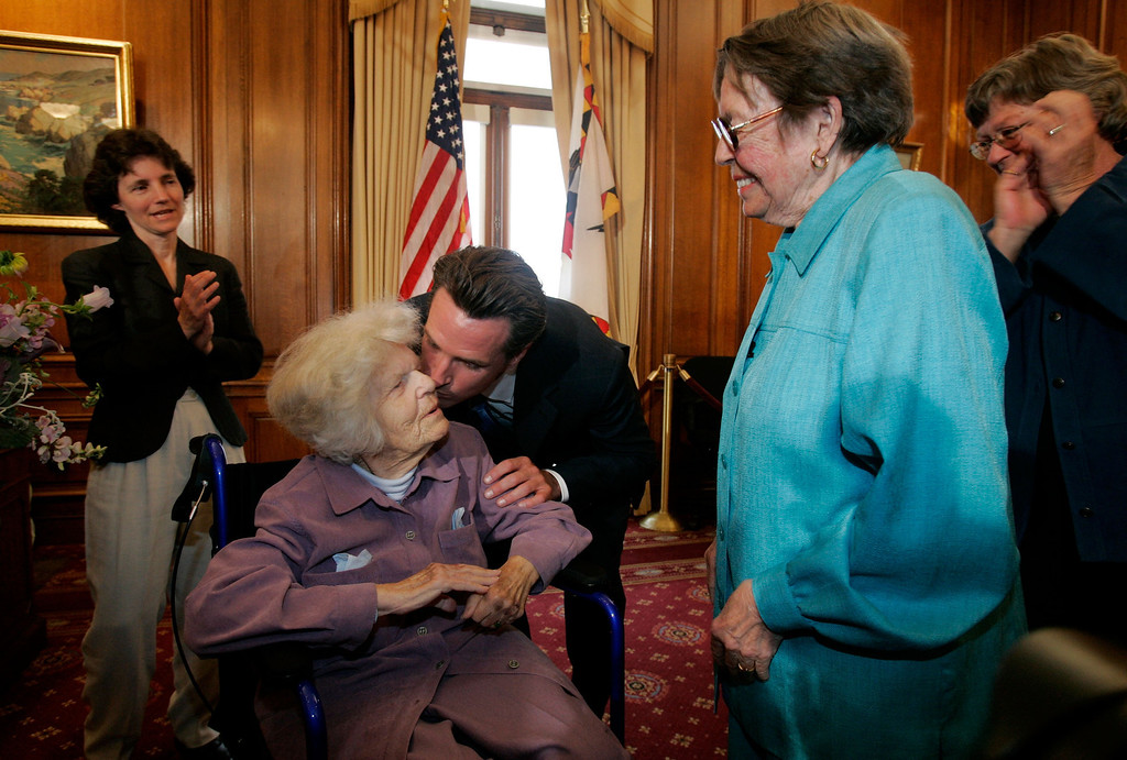 . SAN FRANCISCO - JUNE 16:  Del Martin (L) is kissed by San Francisco mayor Gavin Newsom (C) as Martin and her partner Phyllis Lyon (R) are married by in a private ceremony at San Francisco City Hall June 16, 2008 in San Francisco, California. Martin and Lyon were the first couples to be married in San Francisco as same-sex marriages become legal  in California.  (Photo by Marcio Jose Sanchez-Pool/Getty Images)