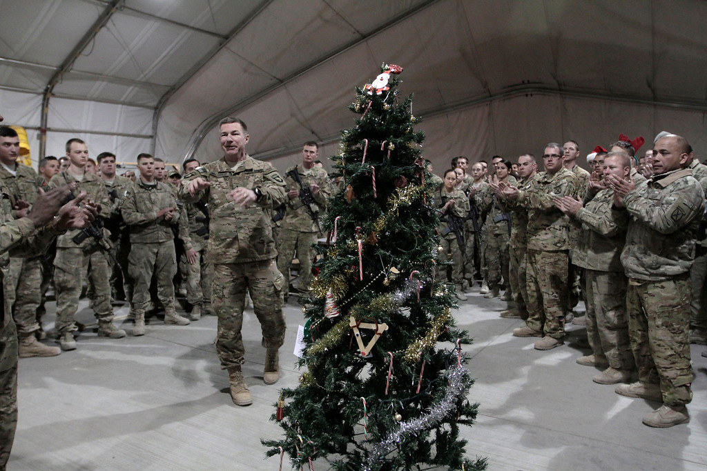 . U.S. Maj. Gen. James C. McConville, left, speaks with soldiers at a base during a Christmas visit in Logar province, eastern Afghanistan, Wednesday, Dec. 25, 2013. he commander of NATO forces in eastern Afghanistan spent Christmasvisiting U.S. troops at bases across the mountainous region to bring them holiday greetings and gifts for a few lucky soldiers.(AP Photo/Rahmat Gul)