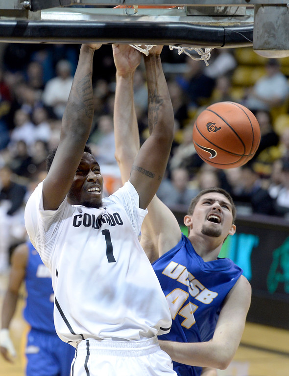 . University of Colorado\'s Wesley Gordon dunks over Sam Beeler during a game against  the University of California Santa Barbara, on Nov. 20, at the Coors Event Center in Boulder.  (Jeremy Papasso/Boulder Daily Camera)