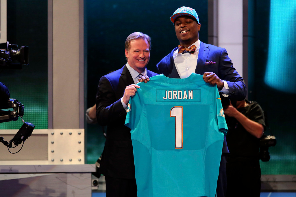 . Dion Jordan, a defensive end from Oregon, stands with NFL Commissioner Roger Goodell after being selected third overall by the Miami Dolphins in the first round of the NFL football draft, Thursday, April 25, 2013, at Radio City Music Hall in New York. (AP Photo/Mary Altaffer)