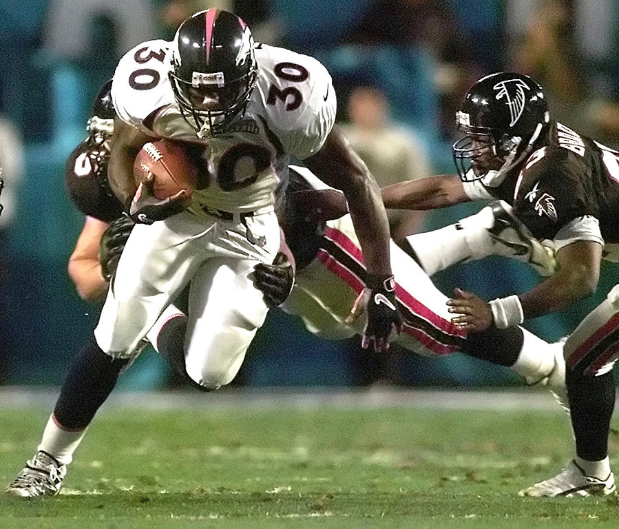 . The Broncos defeated the Falcons by the score of 34�19, winning their second consecutive Super Bowl. The game was played on January 31, 1999, at Pro Player Stadium in Miami, Florida.   Denver running back Terrell Davis, #30, carries an Atlanta defender downfield to gain yardage during the second quarter of Super Bowl XXXIII, at Pro Player stadium in Miami, Florida. (MI) (KRT Direct, KRT/PressLink)