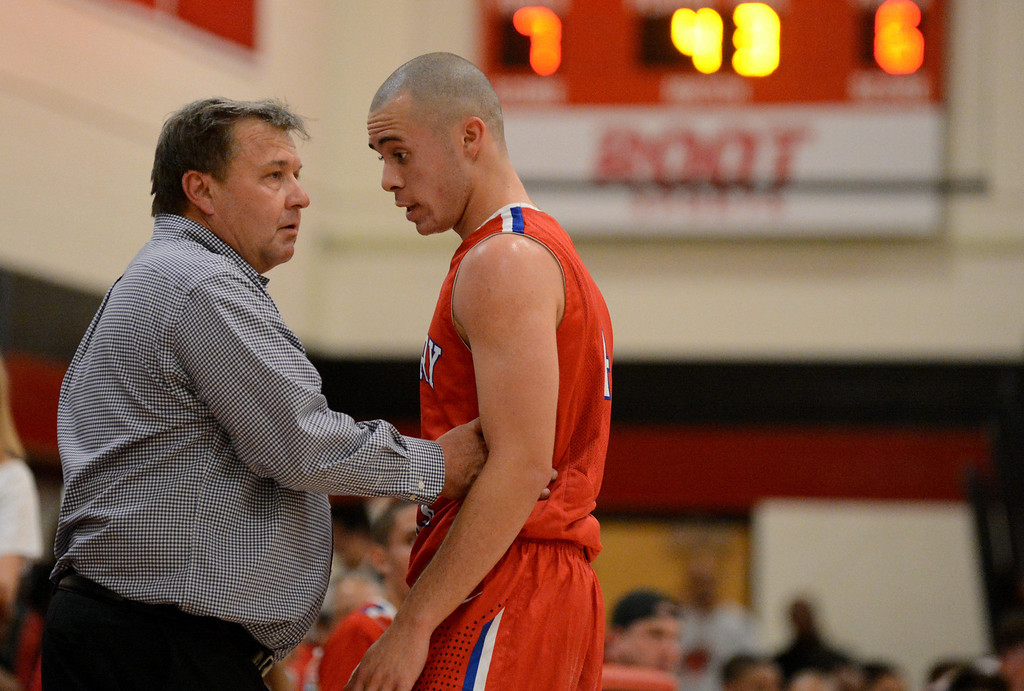 . Cherry Creek\'s head coach Mike Bookhart, left, talks to Sam Stoveall in the 1st half of the game against East\'s at East High School on Friday, Nov. 30, 2012. Hyoung Chang, The Denver Post