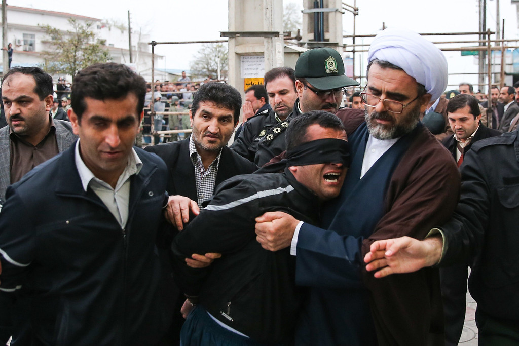 . Balal, who killed an Iranian youth Abdolah Hosseinzadeh in a street fight with a knife in 2007, is brought to the gallows during his execution ceremony in the northern city of Nowshahr on April 15, 2014. AFP PHOTO/ARASH KHAMOOSHI/AFP/Getty Images