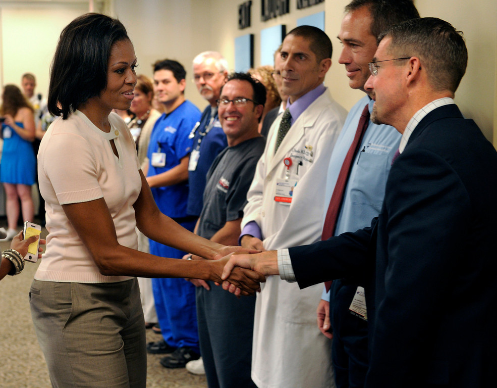 . First Lady Michelle Obama shook hands with Dr. James Denton Saturday during a visit to the Medical Center of Aurora. Obama talked with doctors, nurses and other hospital staff members during a visit to the hospital  Saturday afternoon, August 11, 2012. Dr. Denton was one of several surgeons who responded to the dozens of victims brought to the hospital following the Aurora theater shooting in July. Karl Gehring/The Denver Post