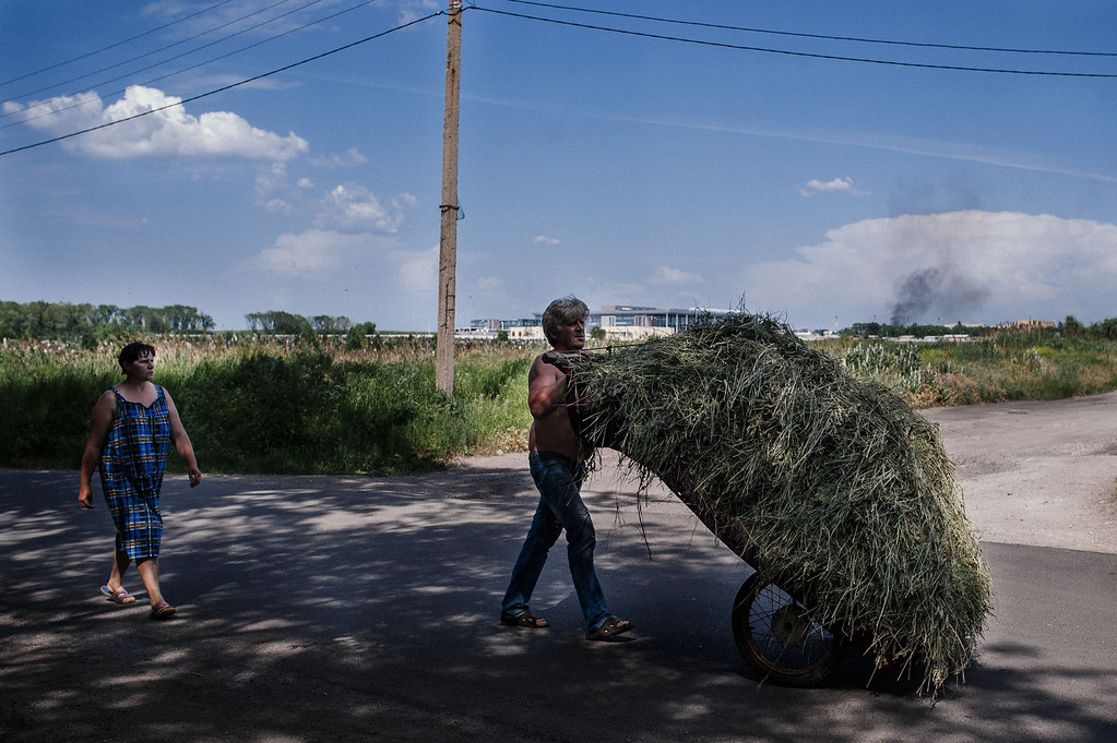 . A farmer pushes a cart with hay near Donetsk international airport during a heavy gun battle between Ukrainian and pro-Russian forces in the eastern Ukrainian city of Donetsk on May 26, 2014. A fierce battle erupted for control of the main airport in rebel-held eastern Ukraine, just hours after future president Petro Poroshenko vowed he would not let the country become another Somalia. DIMITAR DILKOFF/AFP/Getty Images