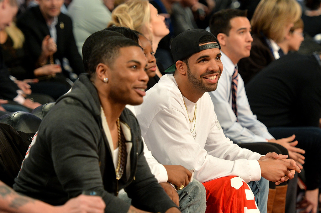 . NEW ORLEANS, LA - FEBRUARY 15: Nelly (L) and Drake attend the State Farm All-Star Saturday Night during the NBA All-Star Weekend 2014 at The Smoothie King Center on February 15, 2014 in New Orleans, Louisiana.  (Photo by Mike Coppola/Getty Images)