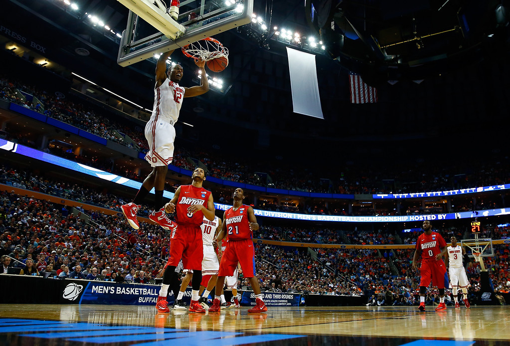 . Sam Thompson #12 of the Ohio State Buckeyes dunks against the Dayton Flyers during the second round of the 2014 NCAA Men\'s Basketball Tournament at the First Niagara Center on March 20, 2014 in Buffalo, New York.  (Photo by Jared Wickerham/Getty Images)
