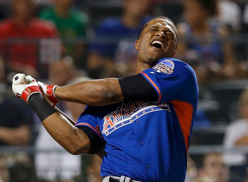 . American League batter Robinson Cano, of the New York Yankees, reacts while managing to hit only four home runs in the first round during the Major League Baseball All-Star Game Home Run Derby in New York, July 15, 2013. REUTERS/Mike Segar