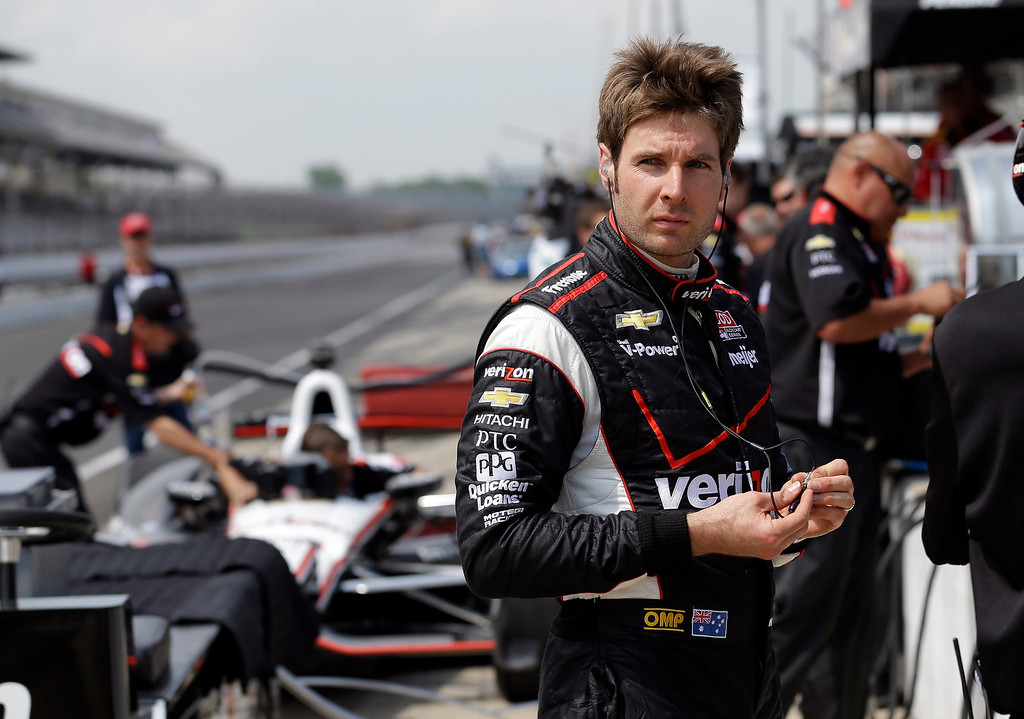 . Will Power, of Australia, looks down the pit lane after driving during practice for the Indianapolis 500 auto race at the Indianapolis Motor Speedway in Indianapolis, Thursday, May 16, 2013. (AP Photo/Michael Conroy)