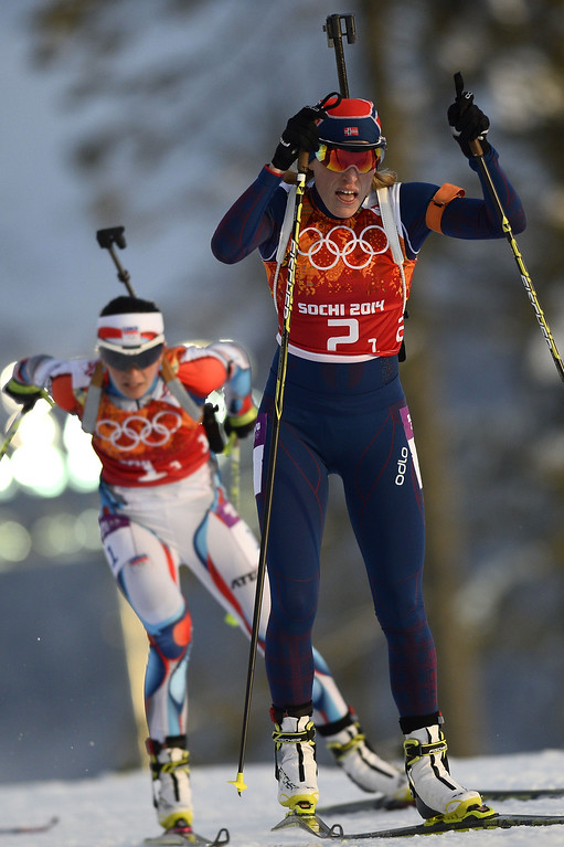 . Norway\'s Tora Berger (R) and Czech Republic\'s Veronika Vitkova compete in the Biathlon mixed 2x6 km + 2x7,5 km Relay at the Laura Cross-Country Ski and Biathlon Center during the Sochi Winter Olympics on February 19, 2014 in Rosa Khutor near Sochi. AFP PHOTO / PIERRE-PHILIPPE  MARCOU/AFP/Getty Images