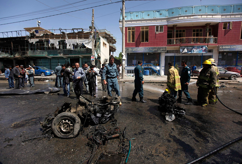 . Afghan policemen stand guard at the site of a suicide attack in Kabul May 16, 2013.  REUTERS/Mohammad Ismail