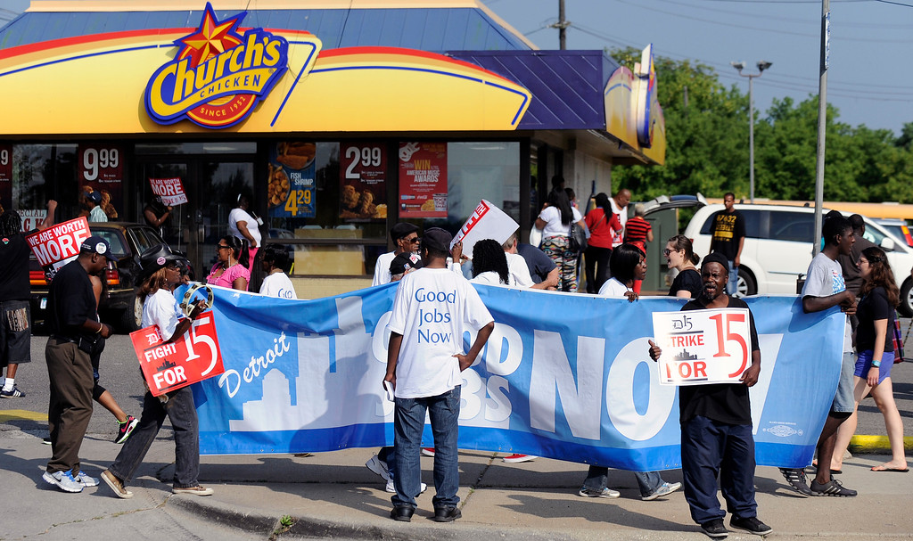 . Demonstrators picket in front of the Church\'s Chicken fast food restaurant in Detroit on Thursday, Aug. 29, 2013.  (AP Photo/Detroit News, David Coates)