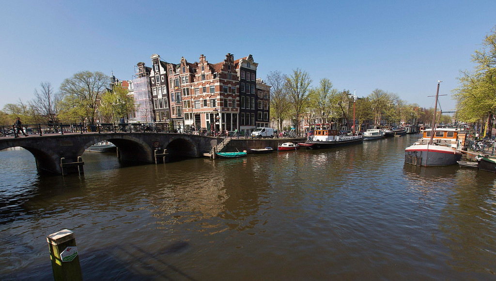 . A view of one of the most photographed buildings at the intersection of Prinsengracht and Brouwersgracht canal in Amsterdam April 24, 2013. The Royal celebrations in the Netherlands this week put the country and the capital Amsterdam on front pages and television screens around the world with an orange splash. There\'s plenty to see and do in 48 hours in this compact city, where the world-famous Rijksmuseum only recently reopened after an extensive renovation. Picture taken April 24, 2013.  REUTERS/Michael Kooren