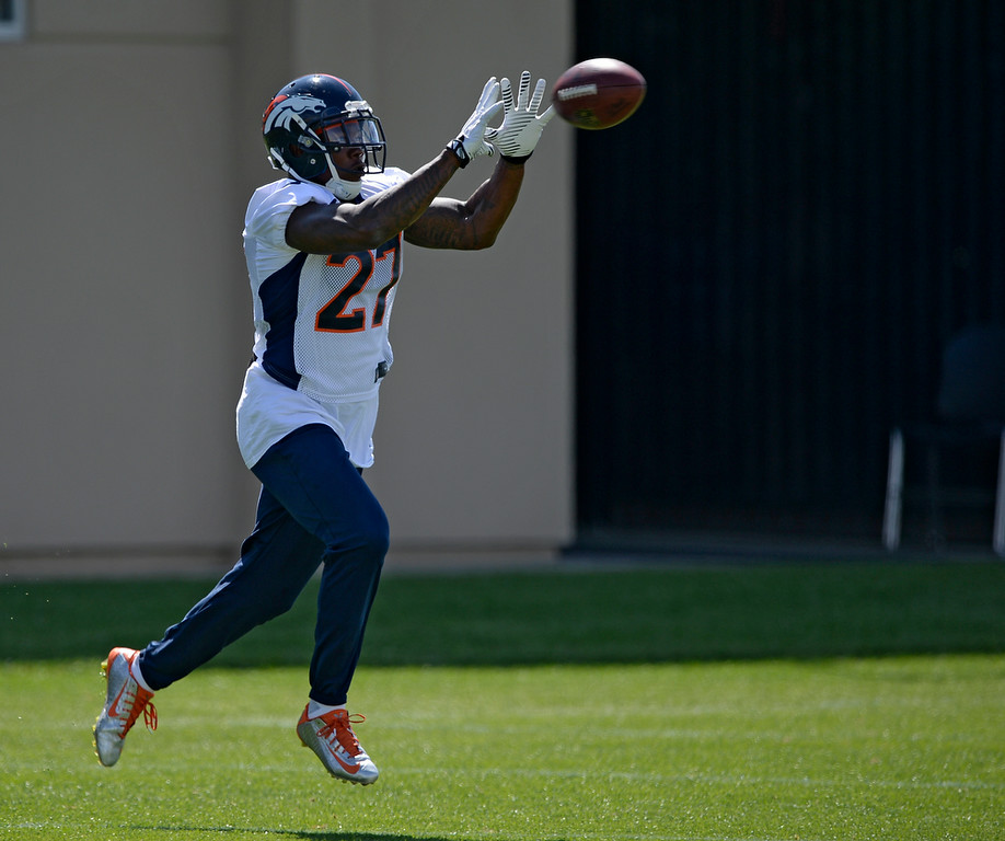 . Denver Broncos strong safety Duke Ihenacho (27) catches a pass during practice August 25, 2014 at Dove Valley.(Photo by John Leyba/The Denver Post)