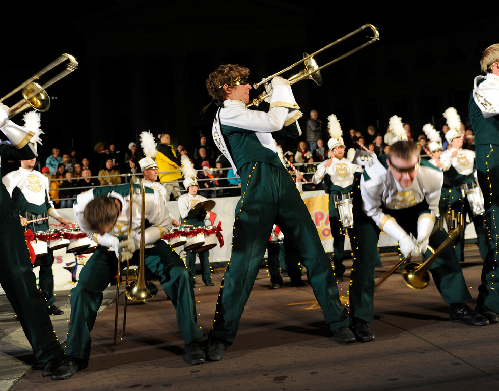 . The Colorado State University Marching Band performed the blindfolded trombone suicide slide Friday night. The annual Parade of Lights filed wound its way through downtown Denver Friday night, November 30. 2012. The parade with 11 floats, 7 bands, 5 giant balloons and more lights than anyone could count, had enough holiday spirit to cheer even the biggest Scrooge. A repeat performance is on tap for Saturday night. Karl Gehring/ The Denver Post