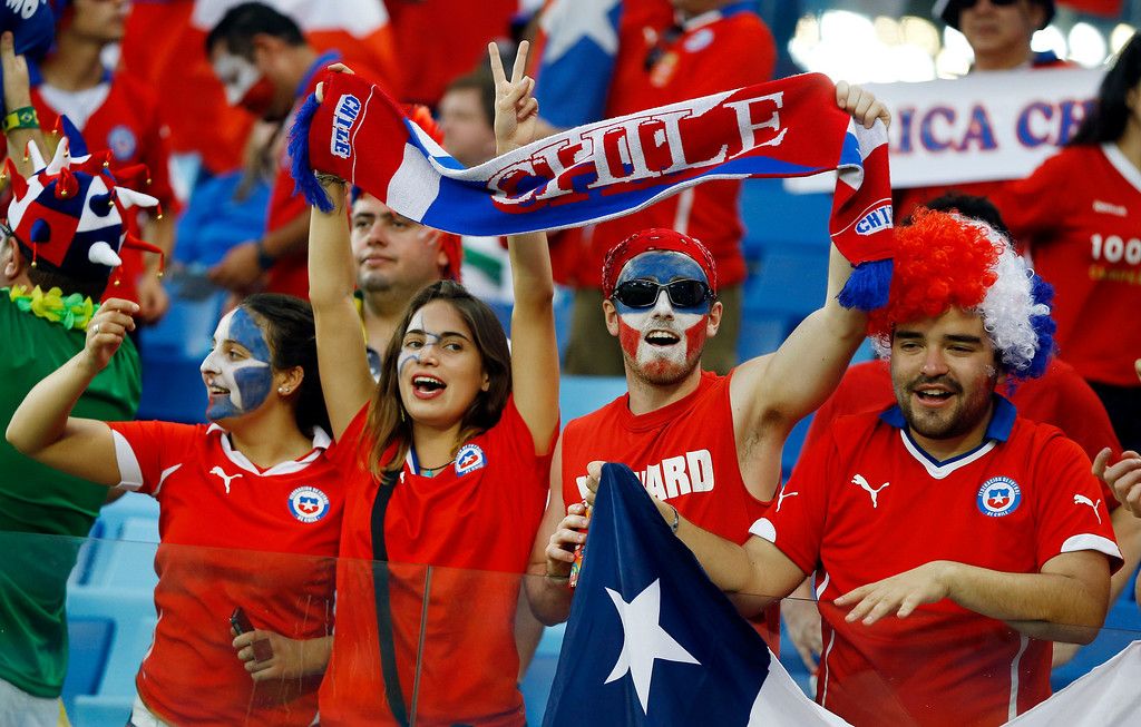 . Chilean fans cheer before the start of the group B World Cup soccer match between Chile and Australia in the Arena Pantanal in Cuiaba, Brazil, Friday, June 13, 2014.  (AP Photo/Kirsty Wigglesworth)