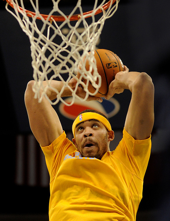. DENVER, CO. - NOVEMBER 1:  Denver center JaVale McGee flew towards the net during warmups before the game. The Denver Nuggets hosted the Portland Trail Blazers Friday night, November 1, 2013 at the Pepsi Center.  Photo By Karl Gehring/The Denver Post
