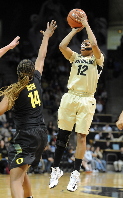 . Ashley Wilson of CU puts up a shot over Jillian Alleyne of Oregon. Cliff Grassmick / February 10, 2013
