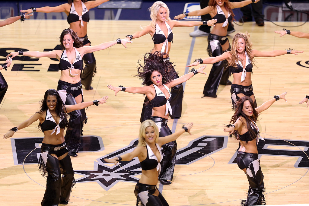 . San Antonio Spurs dancers perform during a break in the game against the Miami Heat during Game Three of the 2013 NBA Finals at the AT&T Center on June 11, 2013 in San Antonio, Texas.   (Photo by Christian Petersen/Getty Images)