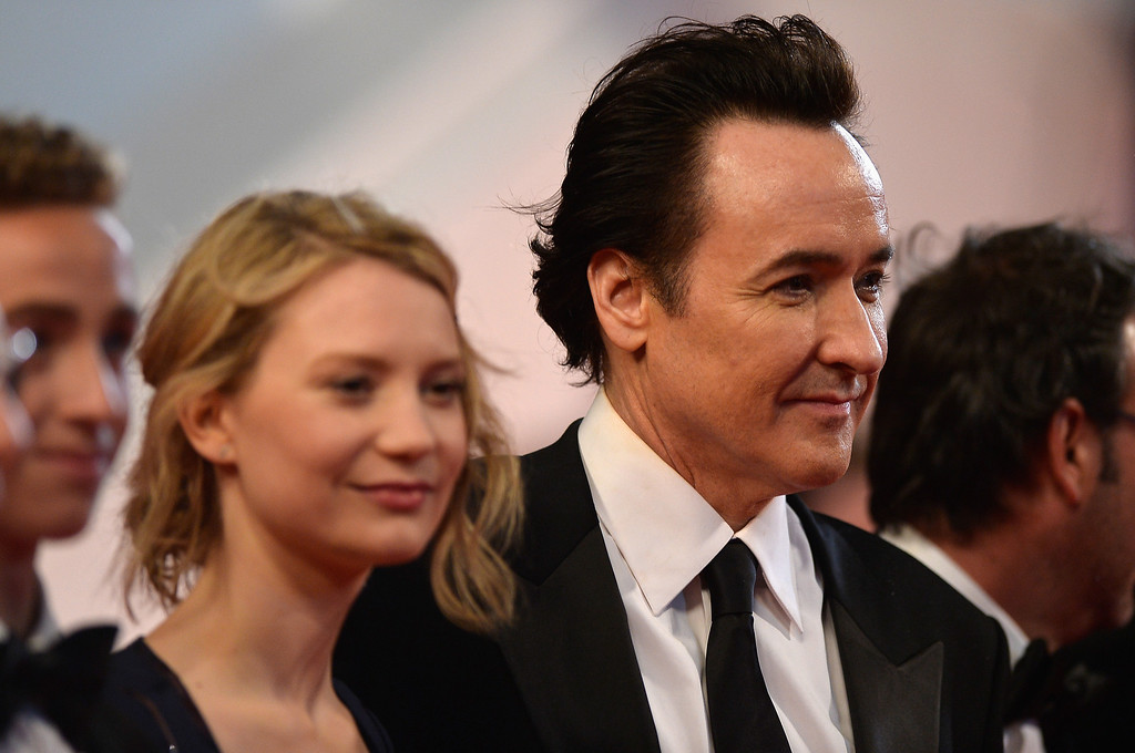 ". Mia Wasikowska (L) and John Cusack attend the ""Maps To The Stars\"" premiere during the 67th Annual Cannes Film Festival on May 19, 2014 in Cannes, France.  (Photo by Pascal Le Segretain/Getty Images)"