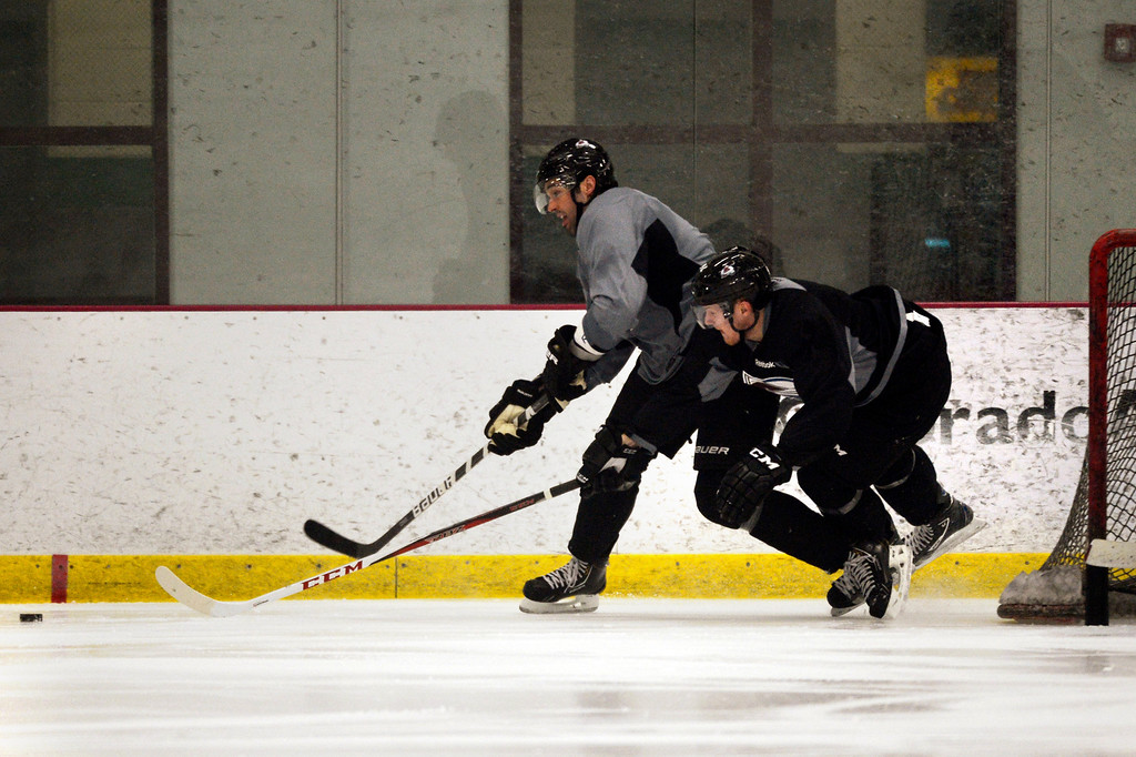 . Colorado Avalanche left wing Gabriel Landeskog #92 takes out defenseman Ryan O\'Byrne #3 at training camp practice at Family Sports Center in Centennial, Colorado, Monday, January 14,  2013.    Joe Amon, The Denver Post