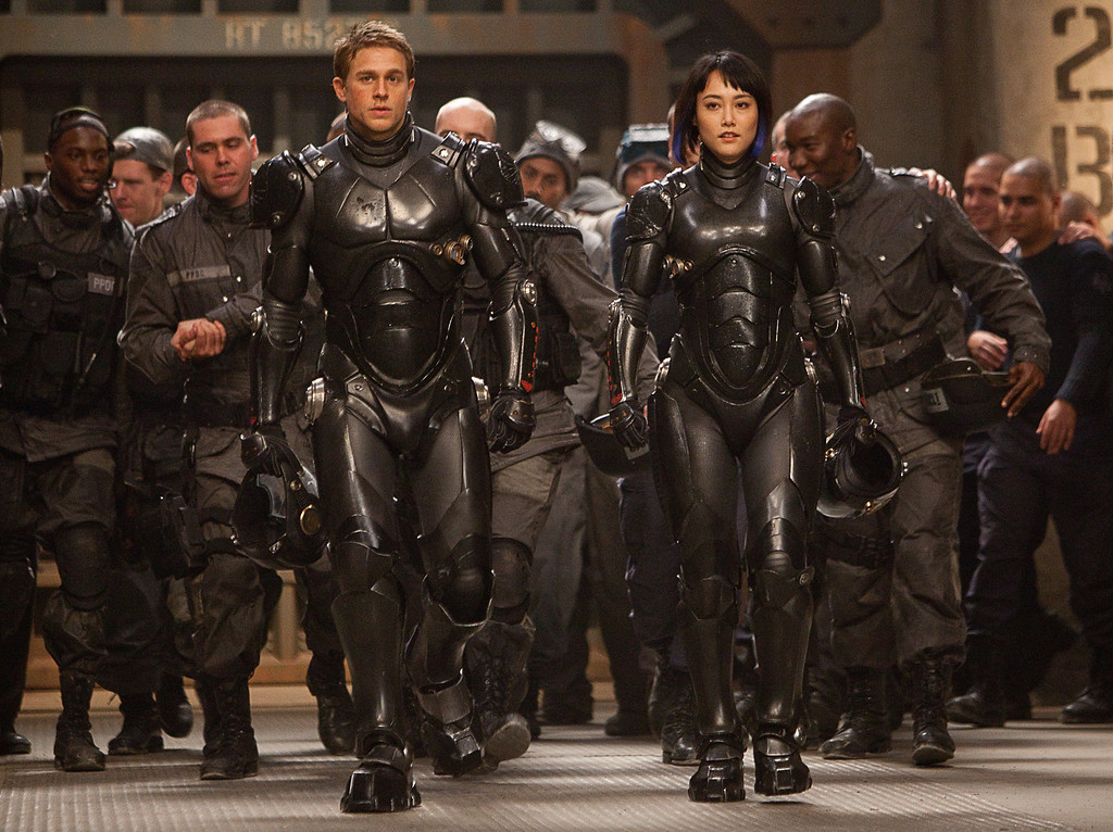". (Front l-r) CHARLIE HUNNAM as Raleigh Becket and RINKO KIKUCHI as Mako Mori in Warner Bros. Pictures and Legendary Pictures� sci-fi action adventure ""PACIFIC RIM,\"" a Warner Bros. Pictures release."