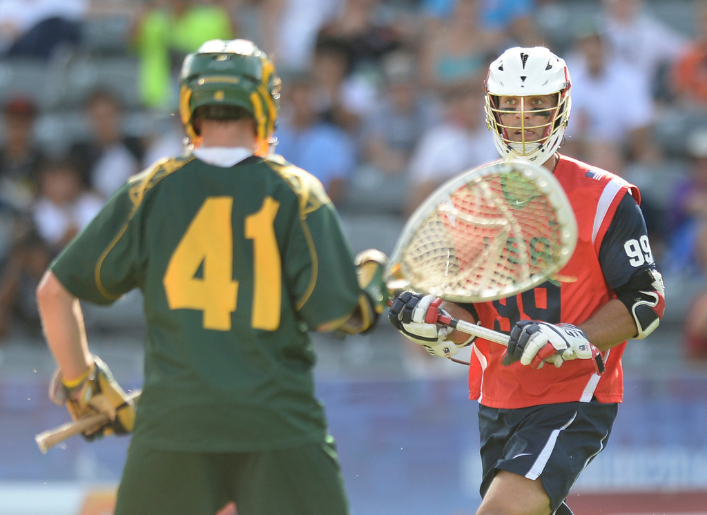 . COMMERCE CITY, CO - JULY 17: US midfielder Paul Rabil (99) stared down Australia goalie Warren Brown (41) in the second half. Team USA faced Australia in a FIL World Championship semifinal game Thursday night, July 17, 2014.  Photo by Karl Gehring/The Denver Post