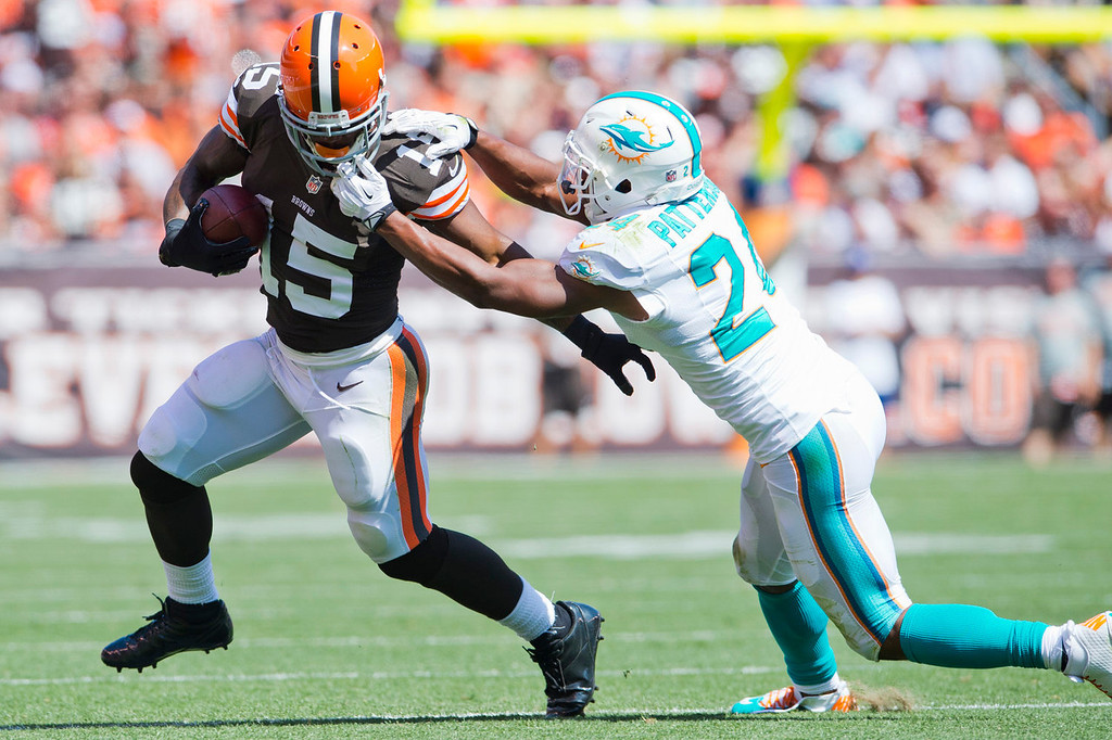 . Wide receiver Davone Bess #15 of the Cleveland Browns hangs on to the ball as cornerback Dimitri Patterson #24 of the Miami Dolphins commits a penalty during the first half at First Energy Stadium on September 8, 2013 in Cleveland, Ohio. (Photo by Jason Miller/Getty Images)