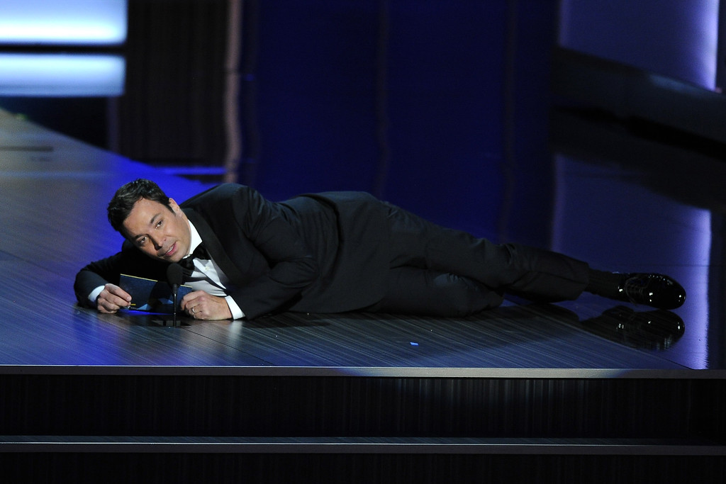 . Jimmy Fallon presents the award for outstanding lead actress in a drama series at the 65th Primetime Emmy Awards at Nokia Theatre on Sunday Sept. 22, 2013, in Los Angeles.  (Photo by Chris Pizzello/Invision/AP)