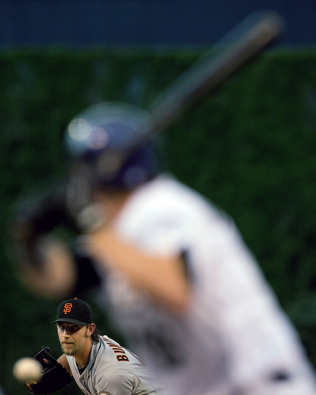 . Starting pitcher Madison Bumgarner #40 of the San Francisco Giants delivers to home plate during the first inning against the Colorado Rockies at Coors Field on August 28, 2013 in Denver, Colorado.  (Photo by Justin Edmonds/Getty Images)
