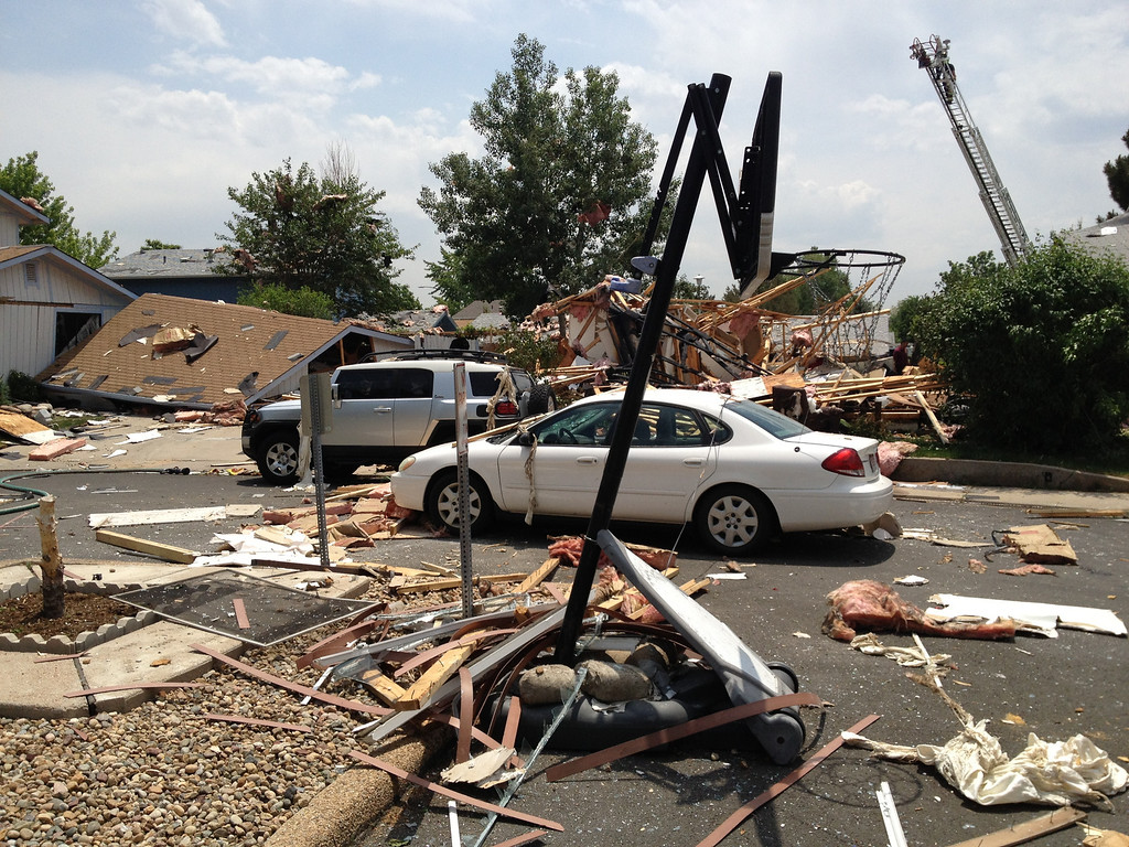 . Four houses were damaged by a blast, with two sustaining heavy damage Thursday, June 13, 2013. Preliminary indications are that a natural gas leak led to the explosion. Andy Cross, The Denver Post