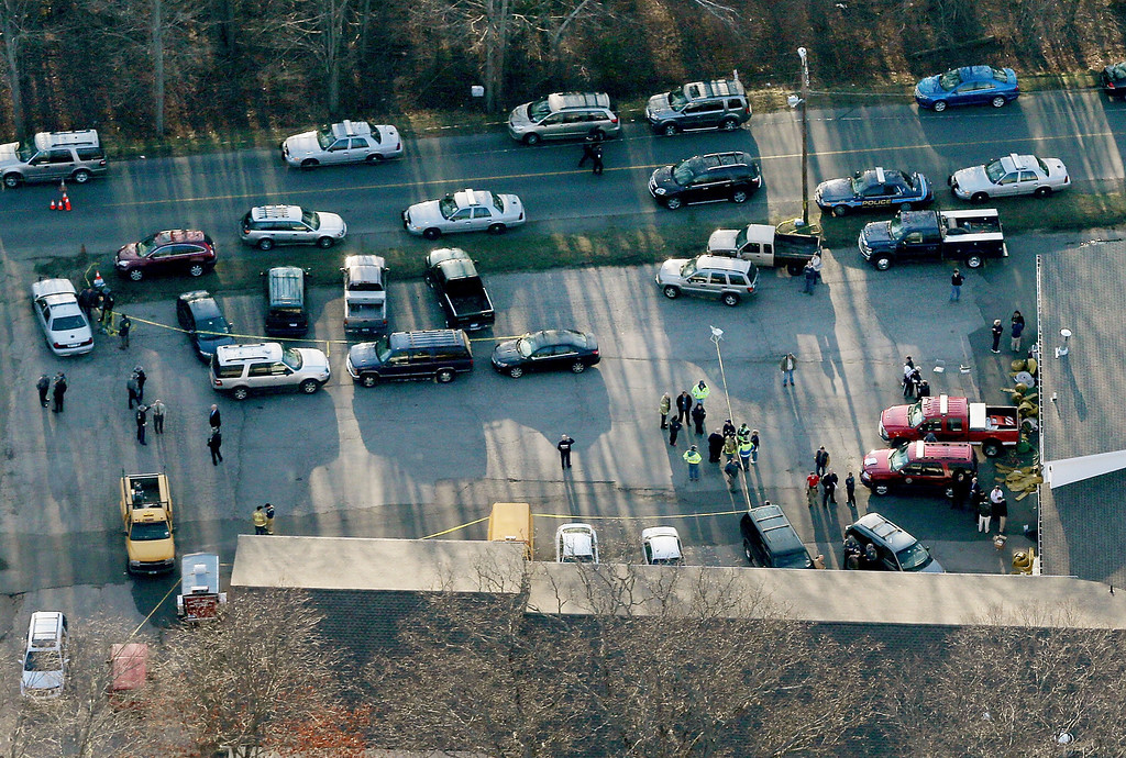 . People gather at a fire station that was set up as a triage area near the scene of a mass school shooting at Sandy Hook Elementary School on December 14, 2012 in Newtown, Connecticut. There are 27 dead, 20 of them children, after Adam Lanza reportedly opened fire in one of the largest school massacres in U.S. history. Lanza is dead at the scene and his mother, a teacher at the school, is also dead.  (Photo by Mario Tama/Getty Images)