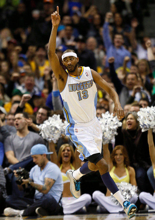 . Denver Nuggets\' Corey Brewer celebrates scoring over the Oklahoma City Thunder in their NBA basketball game in Denver March 1, 2013. REUTERS/Rick Wilking