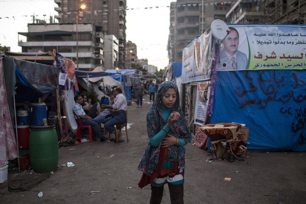 . A young Egyptian girl attends a sit-in demonstration in support of deposed Egyptian President Mohammed Morsi near the Rabaa al-Adweya Mosque in the Nasr City district on August 12, 2013 in Cairo, Egypt. Egyptian security forces threatened to begin a siege of pro-Morsi protest camps in Cairo overnight on August 11, however Egypt\'s Interior Ministry appeared to have put off plans to crack down on protesters early on Monday. Morsi supporters have continued to protest at sites across Cairo over one month after the Egyptian military deposed Egypt\'s first democratically elected President, Mohammed Morsi, on July 3. (Photo by Ed Giles/Getty Images).